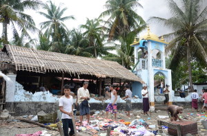 Local Arakanese dismantle and loot the site of a destroyed mosque in Sittwe, June 2012. © 2012 Private