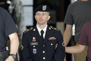 Army Pfc. Bradley Manning is escorted out of a courthouse in Fort Meade, Md., Wednesday, June 5, 2013, after the third day of his court martial. Manning is charged with indirectly aiding the enemy by sending troves of classified material to WikiLeaks. He faces up to life in prison. (AP Photo/Patrick Semansky)