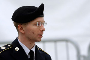 Army Pfc. Bradley Manning is escorted into a courthouse in Fort Meade, Maryland, Tuesday, May 21, 2013, before a pretrial military hearing. (AP Photo/Patrick Semansky)