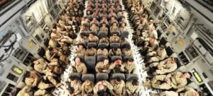 U.S. servicemen inside a plane. (photo: Vyacheslav Oseledko/AFP/Getty Images)