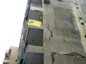 Four buildings surrounding the parking lot had their massive concrete walls cracked.