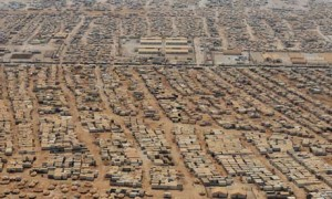 The Zaatari refugee camp near the Jordanian city of Mafraq shelters 115,000 Syrian refugees, posing a humanitarian crisis and a threat to global security, say UN officials. Photograph: Mandel Ngan/AFP/Getty Images