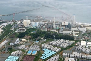An aerial view shows the Fukushima Daiichi nuclear power plant and its storage tanks for contaminated water (bottom) August 20. Leakage from a temporary storage tank has raised new concerns about the ongoing problems at the plant. Photograph by Kyodo/Reuters. Published August 21, 2013