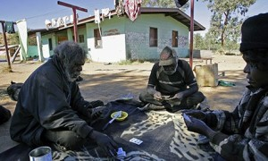 Aboriginal elders playing cards in their camp near Alice Springs. 'A typical, dilapidated house in an outback Indigenous community must accommodate as many as 25 people. Families, the elderly and disabled people wait years for sanitation that works.' Photograph: Anoek De Groot/AFP/Getty Images