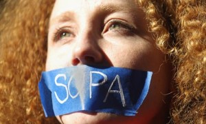 A protester demonstrates against the proposed Stop Online Piracy Act (Sopa) in New York. It might be time to do the same against the Trans-Pacific Partnership. Photograph: Mario Tama/Getty Images