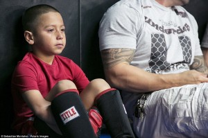 More tears: Sacramento, California, United States: Daniel Arrellano, 6, cries after being defeated in the 2013 California State Pankration Championships Youth Division. Arrellano finished second in the age 5-7 under 55lbs category