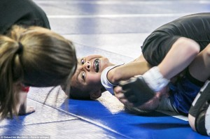 """Effort: Kristofer """"The Arm Collector"""" Arrey, 7, chokes Mason Bramlette, 7, during 2013 California State Pankration Championships Youth Division. Pankration is a version of the popular Mixed Martial Arts (MMA)-style fighting that is adapted for children"""