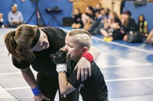 """Tears: Mason """"The Beast"""" Bramlette, 7, cries after receiving a punch during 2013 California State Pankration Championships Youth Division"""