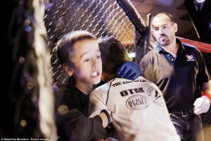 """Parker, Arizona, United States: Kristofer """"The Arm Collector"""" Arrey, 7, pins Cross Betzhold, 6, against the cage during a United States Fight League Pankration All-Star tournament held at the BlueWater Resort and Casino"""