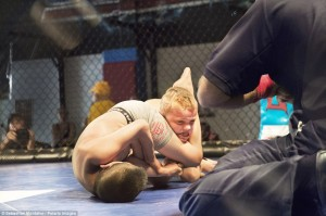 """San Bernardino, California, United States: Mason """"The Beast"""" Bramlette, 7, is choked by his opponent during a Pankration tournament held at Adrenaline Combat Sports and Fitness"""