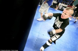 """Sacramento, California, United States: Mason """"The Beast"""" Bramlette, 7, trains at the Ultimate Fitness Gym before the 2013 California State Pankration Championships Youth Division"""