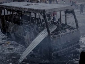 """Ukraine's """"peaceful pro-European"""" protesters leave a burnt land behind. Photo of a burnt police bus taken by S.Morgunov at the Euromaidan in Kyiv on January 20, 2014"""