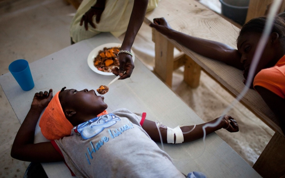 Janika Faneus is fed by her mother while receiving treatment for cholera at a Doctors Without Borders cholera clinic in Saint-Marc, Haiti, on Jan. 22, 2011. Rodrigo Abd/AP