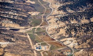 A large field of fracking sites in a Colorado valley. 'The industry's singular solution to the climate crisis is to dramatically expand an extraction process that releases massive amounts of climate-destabilising methane.' Photograph: Ted Wood/Aurora Photos/Corbis