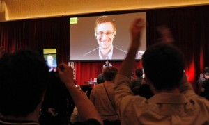 Supporters of Amnesty International cheer as Edward Snowden is introduced via video at a conference in Chicago on Saturday [5 Apr 2014]. Photograph: Frank Polich/Reuters