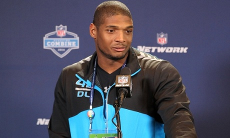 defensive end Michael Sam speaks to the press at the NFL Combine. Photograph: Pat Lovell/USA Today Sports