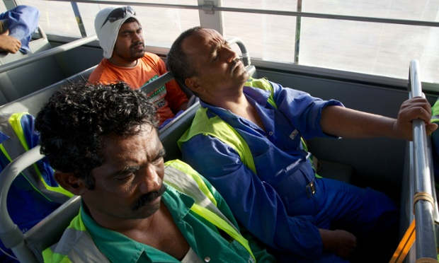 Exhausted migrant workers at the end of the day in Qatar. Pete Pattisson for the Guardian