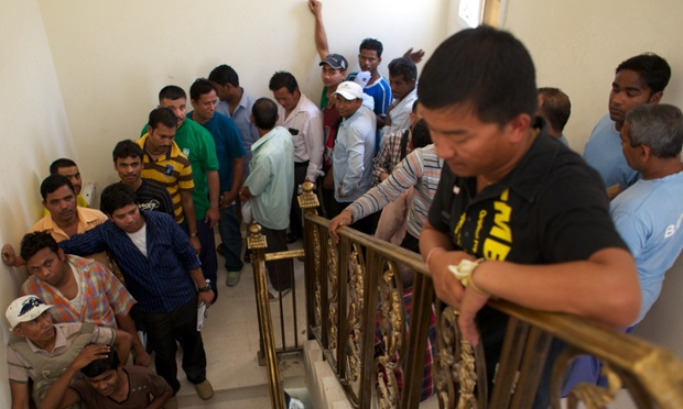 Nepalese migrant workers queue up at the Nepalese embassy in Doha to renew their passports. Pete Pattisson for the Guardian