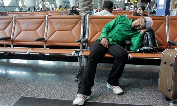 A migrant worker from Nepal waits to be picked up by his employer in the arrivals hall of Hamad International Airport. Pete P