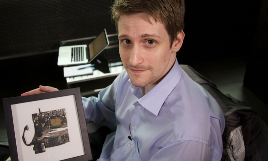 Edward Snowden with a fragment of a smashed-up Guardian laptop. Photograph: Alan Rusbridger for the Guardian