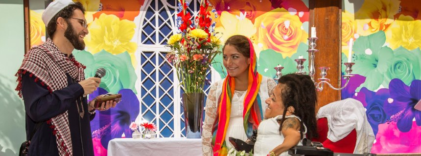 Lesbian couple Sahar Mosleh (right) and Maryam Iranfar receive a blessing at their wedding ceremony performed by gay imam Ludovic Mohamed Zahed in Stockholm.