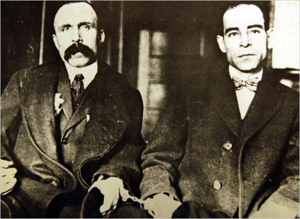 Bartolomeo Vanzetti (left) and Nicola Sacco in handcuffs