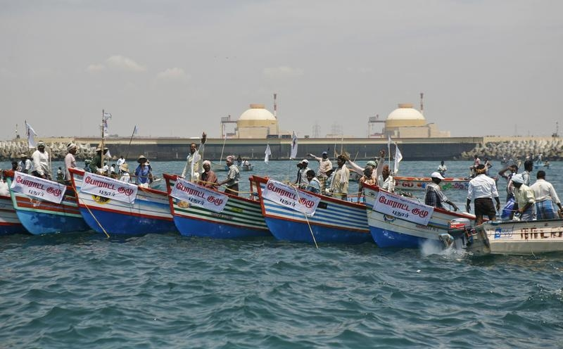 Demonstrators stand in their boats in the Bay of Bengal during a protest near the Kudankulam nuclear power project in the southern Indian state of Tamil Nadu on October 8, 2012. © 2012 Reuters
