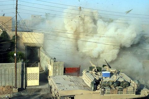 Demolition of Iraqi buildings with a US tank, many of which used depleted uranium shells.