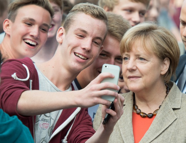 German Chancellor Angela Merkel with college students. CREDIT: AP Photo/Michael Probst