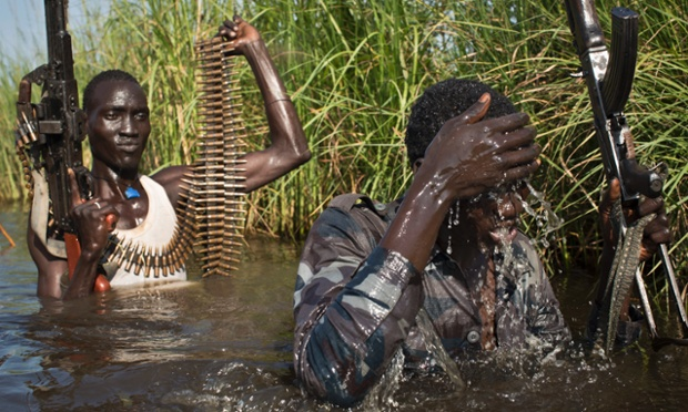 Rebel soldiers patrol and protect civilians from the Nuer ethnic group as they walk through flooded areas in the town of Bentiu, South Sudan in September. Photograph: Matthew Abbott/AP