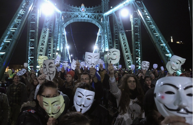 "Supporters of the Anonymous movement rally in Budapest as part of the global ""Million Mask March"" protests, November 5, 2014. (Reuters/Bernadett Szabo)"