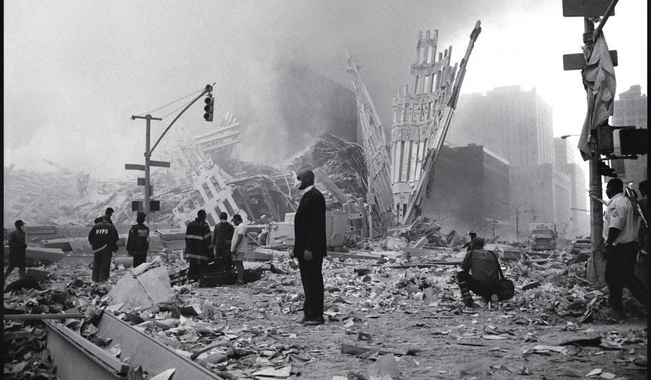 A minister stands amid the wreckage of the world trade center seemingly dazed from the
