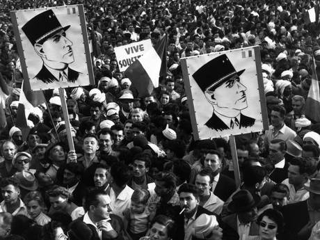 A crowd of Algerian demonstrators outside Government House, carrying Charles de Gaulle posters during the Algerian war of independence in 1985 (Getty Images)