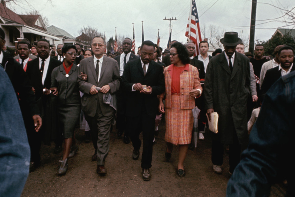 10 of 21Martin Luther King Jr. Photo Gallery: King and his wife, Coretta, march with other civil rights activists through a neighborhood in Selma in 1965. (Photo: Flip Schulke/CORBIS)