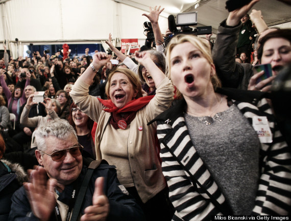 Supporters of the opposition radical leftist Syriza party cheer at exit poll results which indicate that Syriza have a clear lead on January 25, 2015 in in Athens, Greece. (Photo by Milos Bicanski/Getty Images)