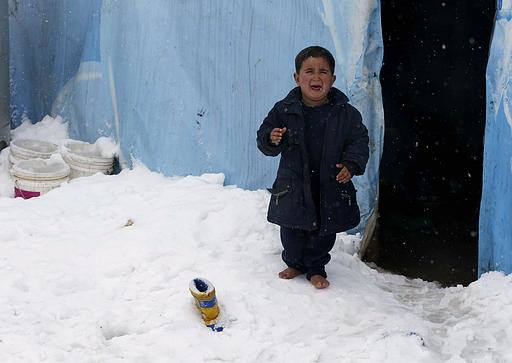 Child refugee from Syria in Lebanon, Jan 2015 under intense snowfall.