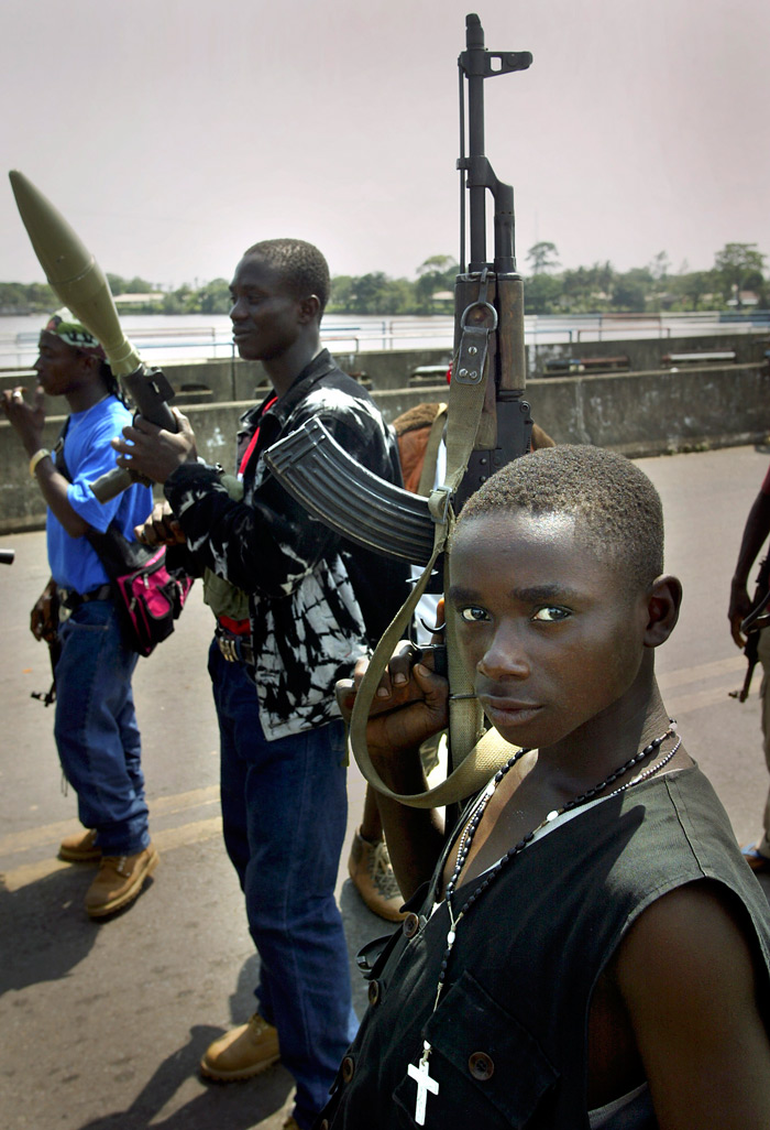 Soldiers stand guard on a bridge in Liberia during fighting in 2003. Photo: AP