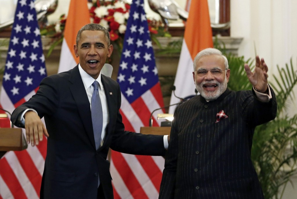 President Obama and Indian Prime Minister Narendra Modi wave after issuing a statement in New Delhi on Jan. 25. (Adnan Abidi/Reuters)
