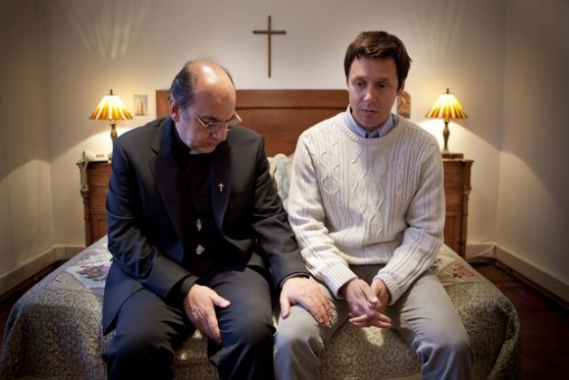 "Actors Luis Gnecco (left) and Benjamín Vicuña in a scene from ""Karadima's Forest"", a film that portrays pedophile Chilean priest Fernando Karadima, seen here with one of his victims, James Hamilton, his ""favourite"", who finally dared to speak out. Credit: Courtesy of Constanza Valderrama"