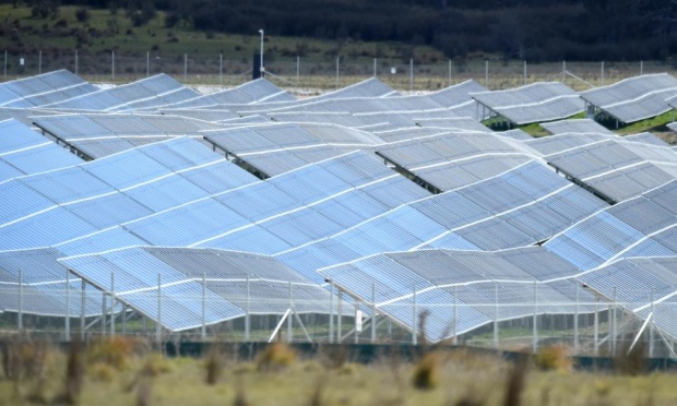 The FRV Royalla solar farm near Canberra is currently Australia's largest at 20MW. This farm is expected to generate an average 37,000 MWh of renewable energy each year and will meet the needs of 4,500 Canberra households. Photograph: Lukas Coch/AAP