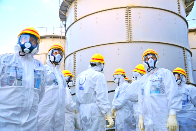 A team of IAEA experts check out water storage tanks TEPCO's Fukushima Daiichi Nuclear Power Station on Nov. 27, 2013. The expert team is assessing Japanese efforts to decommission the stricken nuclear power plant. Photo Credit: Greg Webb / IAEA
