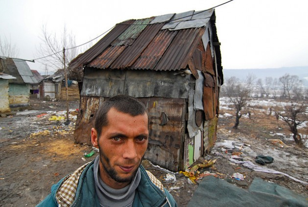 A man lives in the makeshift house behind him in the Slovak Republic, a member of the EU. Photo: Mano Strauch © The World Bank