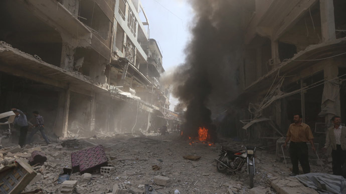 Smoke rises from fire at a site in central Douma, eastern al-Ghouta, near Damascus September 17, 2014 (Reuters / Bassam Khabieh)