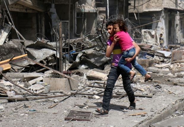 Many of Yarmouk's homes were turned to rubble because of Assad's barrel bombs, shells and airstrikes.