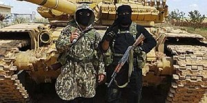 Isis fighters in Syrian with US weapons and tank captured from US trained and armed Iraq army.