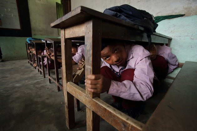 School children in Nepal's Matatirtha village practice an earthquake drill in the event of a natural disaster. A 7.8-magnitude earthquake in Nepal on Apr. 25, 2015, has endangered the lives of close to a million children. Credit: Department of Foreign Affairs and Trade/CC-BY-2.0