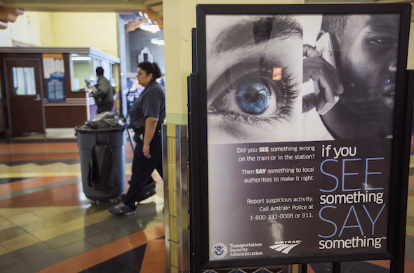 "A Transportation Security Administration sign at Los Angeles' main rail terminal, Union Station, urges that suspicious activities be reported to authorities. It declares, ""If You See Something Say Something."" (AP / Damian Dovarganes)"