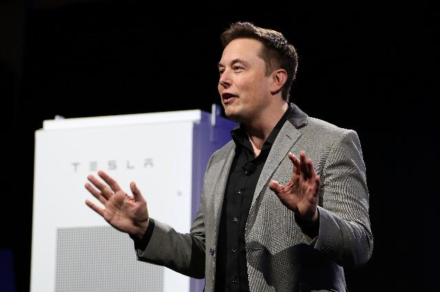 Electric car pioneer Telsa Motors unveiled a 'home battery' Thursday which its founder Elon Musk said would help change the 'entire energy infrastructure of the world.' (Photo by DAVID MCNEW/AFP/Getty Images)