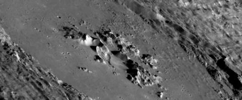 This oblique image highlights the interiors of Abedin Crater. The central peaks in the middle of the depression may have a volcanic origin. Credit: NASA/JHUAPL/CIW