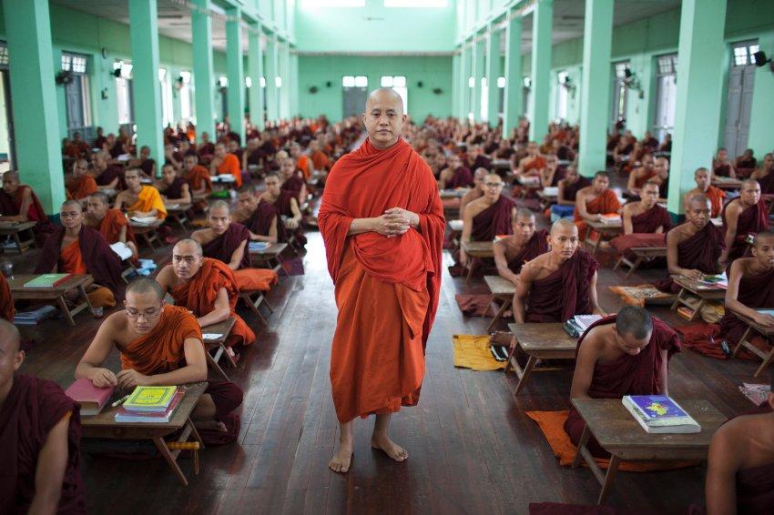Ashin Wirathu walks through a class of Buddhist monks at the Masoeyein monastry in Mandalay, Myanmar (Burma), May 25, 2015.